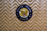 A United States Senate badge is seen inside an elevator inside the U.S. Capitol Building in this photo taken with a tilt-shift lens in Washington, D.C., U.S., on Friday, Oct. 3, 2014.