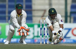 Pakistani batsman Misbah Ul- Haq (R) plays a shot during the second day of the second test cricket match between Pakistan and Australia at Zayed International Cricket Stadium in Abu Dhabi on October 31, 2014.