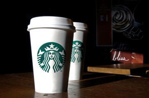 This Friday, Jan. 17, 2014, photo, shows Starbucks mugs in a cafe in North Andover, Mass. Elise Amendola/AP