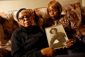 In this March 12, 2014, file photo, Alma Murdough, left, and her daughter Cheryl Warner hold a photo of Murdough's son, Jerome Murdough, at her home in the Queens borough of New York. On Friday, Sept. 12, 2014.