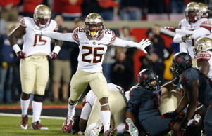 P.J. Williams #26 of the Florida State Seminoles celebrates after a goal line stand on fourth down against the Louisville Cardinals during the game at Papa John's Cardinal Stadium on October 30, 2014 in Louisville, Kentucky. Florida State defeated Louisville 42-31.