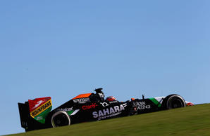 Marussia Formula One driver Jules Bianchi of France drives in front of Caterham Formula One driver Kamui Kobayashi of Japan during the Japanese F1 Grand Prix at the Suzuka Circuit October 5, 2014.