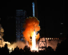 In this photo released by China's Xinhua News Agency, an unmanned spacecraft is launched atop an advanced Long March 3C rocket from the Xichang Satellite Launch Center in southwest China's Sichuan Province, Oct. 24, 2014.