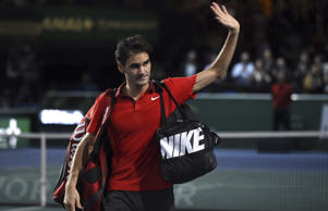Roger Federer has not given up hope of finishing the year as number one despite defeat to Milos Raonic at the Paris Masters.