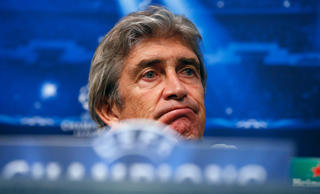 Manchester City manager Manuel Pellegrini attends a news conference at Etihad Stadium