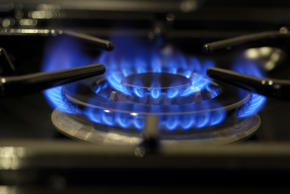 Lighted gas burner on domestic range cooker