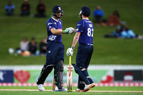 Martin Guptill and Colin Munro of the Auckland Aces touch gloves during the Domestic Twenty20 match between Otago Volts and the Auckland Aces at Seddon Park on November 1, 2014 in Hamilton, New Zealand.