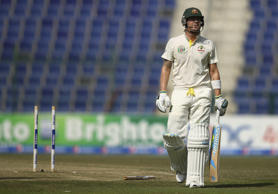 Michael Clarke of Australia looks dejected after being bowled by Imran Khan of Pakistan during Day Two of the Second Test between Pakistan and Australia at Sheikh Zayed Stadium on November 1, 2014 in Abu Dhabi, United Arab Emirates.
