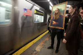 A woman dressed as the Mona Lisa waits to ride the subway after participating in the Village Halloween Parade in the Manhattan borough of New York on Oct. 31, 2014.