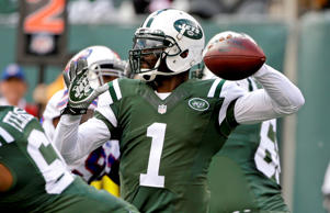 New York Jets quarterback Michael Vick (1) throws a pass during the first half of an NFL football game against the Buffalo Bills, Sunday, Oct. 26, 2014, in East Rutherford, N.J.