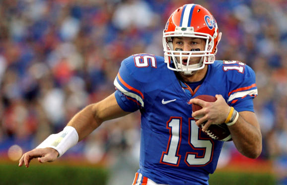 Florida quarterback Tim Tebow scrambles during a NCAA college football game against Arkansas in Gainesville, Fla. on Oct. 17, 2009.
