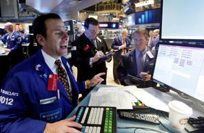 Traders at their post on the floor of the New York Stock Exchange.