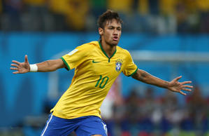 Neymar of Brazil celebrates scoring his goal to make the score 1-1