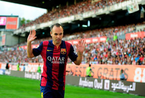 Andres Iniesta of FC Barcelona reacts during the La Liga match between Rayo Vallecano de Madrid and FC Barcelona at Estadio Teresa Rivero on October 4, 2014 in Madrid, Spain.