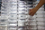 Bars of 100-ounce silver are stacked inside The Safe House, a vault operated by Silver Bullion Pte, in Singapore.