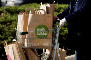 A customer pushes a cart of groceries back to her car after shopping at a Whole Foods Market Inc. store in Dublin, Ohio, U.S., on Friday, Nov. 7, 2014. Whole Foods Market Inc. posted fiscal fourth-quarter profit that topped analysts' estimates as the grocery-store chain slashed prices to win over bargain-hunting shoppers. The shares soared the most in four years. Photographer: Ty Wright/Bloomberg