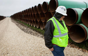 "A worker walks through the TransCanada Corp. Houston Lateral Project pipe yard in Mont Belvieu, Texas, U.S., on Wednesday, March 5, 2014. Russ Girling, TransCanada Corp. president and chief executive officer, said he remains ""optimistic"" that market forces will see that the embattled Keystone XL oil sands pipeline is built, but the real question is when. Scott Dalton/Bloomberg"
