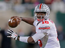 Ohio State quarterback J.T. Barrett looks to pass during the first half of an NCAA college football game against Michigan State in East Lansing, Mich., Saturday, Nov. 8, 2014. Barrett threw for three touchdowns and ran for two in Ohio State's 49-37 win.