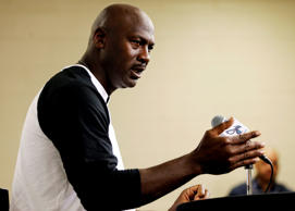 Charlotte Hornets owner Michael Jordan answers a question from the media during a news conference about the NBA basketball team in Charlotte, N.C., Tuesday, Oct. 28, 2014.