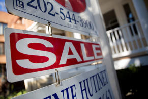 "A John C. Formant Real Estate Inc. ""Sale"" signs stands outside of a house in Washington, D.C. on Friday, Oct. 17, 2014."