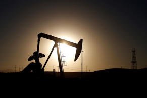 A pump jack is seen at sunrise near Bakersfield, California October 14, 2014. Brent crude hit a new four-year low on Wednesday before recovering to just under $85 a barrel, as faltering global growth curbed demand for fuel at a time of heavy oversupply. Oil saw its biggest daily fall in more than three years on Tuesday after the West's energy watchdog slashed its forecasts for world oil demand for this year and 2015.