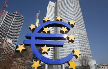 The Euro logo is seen in front of the European Central Bank, ECB in Frankfurt am Main, central Germany, on March 6, 2014.