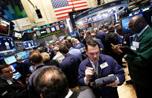 Traders work during the IPO of Mobile game maker King Digital Entertainment Plc on the floor of the New York Stock Exchange March 26, 2014.