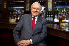 Investor Warren Buffett poses for a portrait during an interview after a luncheon to benefit the Glide Foundation of San Francisco in New York April 23, 2014. Buffett, chairman of conglomerate Berkshire Hathaway, said on Wednesday he thinks Coca-Cola's  controversial equity compensation plan was excessive, but that Berkshire Hathaway abstained in the shareholders vote. Buffett said he has no intention of selling any Coca-Cola shares.