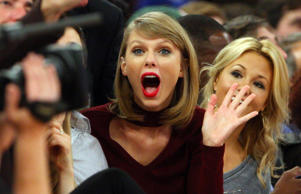 Recording artist Taylor Swift reacts during a photo with Justin Verlander courtside at the New York Knicks vs. Orlando Magic basketball game at Madison Square Garden on Nov. 12.