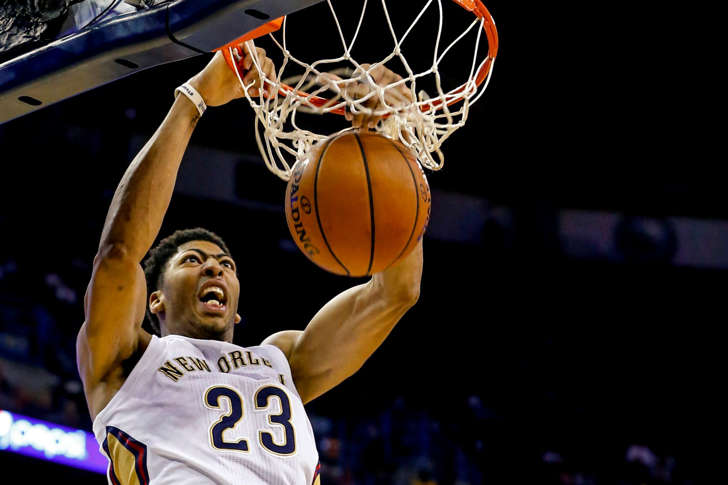 New Orleans Pelicans forward Anthony Davis (23) dunks against the Los Angeles Lakers during the second quarter of a game at the Smoothie King Center.
