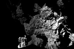 This Nov. 13, 2014 handout photo provided by the European Space Agency (ESA) shows the surface of the 67P/Churyumov-Gerasimenko comet as seen from the Philae lander, which successfully landed on the comet's surface on Nov. 12, despite some malfunctions on the Philae craft. It is the first man-made craft to land on a comet.