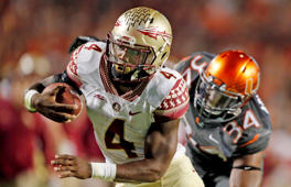 Dalvin Cook #4 of the Florida State Seminoles scores the winning touchdown in the fourth quarter against the Miami Hurricanes on November 15, 2014 at Sun Life Stadium in Miami Gardens, Florida. The Seminoles defeated the Hurricanes 30-26.