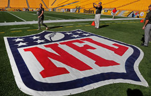 The NFL logo is present on the surface at Heinz Field before a game between the ...
