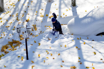 Drew Ahmed makes his way through nearly five feet of snow on November 19, 2014 in the Lakeview neighborhood of Buffalo, New York. The record setting Lake effect snowstorm dumped up to six feet of snow in less than 24 hours closing a one hundred mile section of The New York State Thruway as well as other major roads around Buffalo. Four deaths have already been  attributed to the storm and a second round beginning late Wednesday evening will bring up to three more feet of snow overnight.