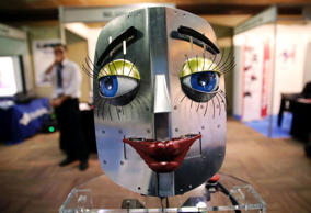 A humanoid robot face is displayed at a stand during the International Conference on Humanoid Robots in Madrid November 19, 2014.