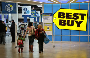 In this Nov. 23, 2013, file photo, shoppers enter a Best Buy store in New York.