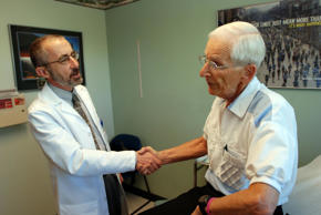 A Medicare patient shakes hands with his doctor after an appointment in Grants P...