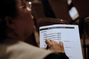 A woman fills out a budget form to receive help with home loan modifications during an event in Los Angeles, California.