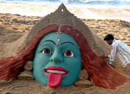Sand artist Sudarshan Pattnaik makes a sculpture of Hindu Goddess Kali on a beach in celebration of the upcoming Hindu festival of Diwali in Puri