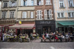 Customers sit at tables at an outdoor cafe terrace in Toulouse, France, on Tuesday, Aug. 12, 2014.