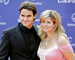 Roger Federer and his partner Mirka Vavrinec pose for photographers as they arrive for the Laureus World Sports Awards in Barcelona, Spain on May 22, 2006.