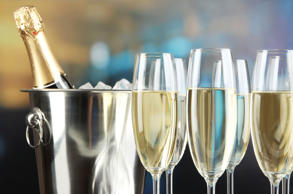Champagne in glasses on  restaurant background belchonock/Getty Images