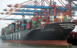 The 'United Kingdom' vessel of the Hanjin shipping company is stevedored at the harbor in Hamburg, Germany, on Oct. 29.
