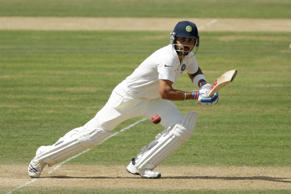 ndia's Virat Kohli hits a shot during the third day of the third cricket test match of the series between England and India at The Ageas Bowl in Southampton, England, Tuesday, July 29, 2014.