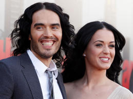 "British actor Russell Brand and his wife Katy Perry arrive for the European premiere of ""Arthur,"" in London. A judge signed off on the couple's divorce Wednesday, but the pair will have to wait until July 14 until they are legally single again. Financial details of the split are confidential."