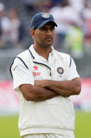 India's captain MS Dhoni stands on the pitch after his team's innings and 54 run loss to England on the third day of the fourth test match of their five match series at Old Trafford cricket ground, in Manchester, England, Saturday, Aug. 9, 2014.