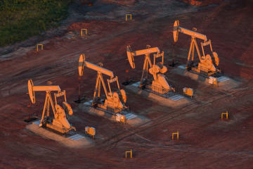 Pumpjacks are seen in an aerial view in the early morning hours of July 30, 2013 near Watford City, North Dakota.