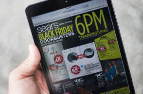 A 'Black Friday' advertisement for Sears is seen on an iPad in Annapolis, Maryland November 16, 2014. 'Black Friday' is coming early this year to retailers, as many plan to open on November 27, Thanksgiving Day.