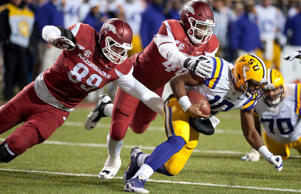 Arkansas' Mitchell Loewen (89) and Deatrich Wise Jr. (48) make the sack on LSU quarterback Anthony Jennings (10) during the second half of an NCAA college football game in Fayetteville, Ark., Saturday, Nov. 15, 2014.