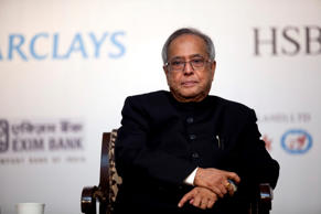 File: Pranab Mukherjee reacts during the vote of thanks at the Institute Of International Finance (IIF) Spring Membership Meeting in New Delhi, India